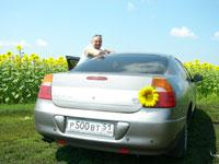 Наш привет всем водителям - желтое солнышко на багажнике нашего авто