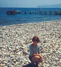 Пляж немного каменистый, дальше песок